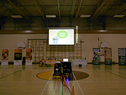 ambassadors set up a presentation in a school gym
