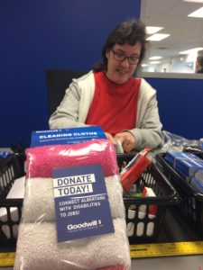 Sonja Fjeldstorm, Goodwill Employee, Prepares Cleaning Cloths